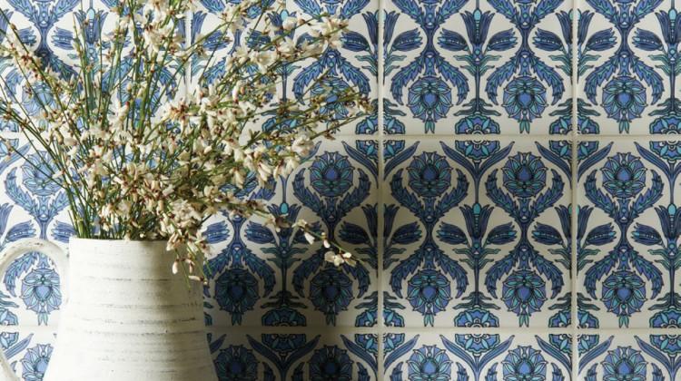 Vase in front of embellished tiles