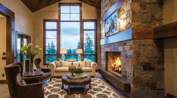 Stone fireplace, living area with scenic view through window