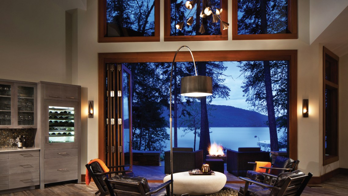 ABOVE This lakeside retreat by Mindful Custom Builders merges indoor and outdoor living using accordion glass doors. PHOTO Gibeon Photography