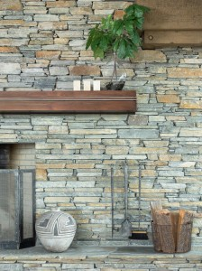 Snake River Interiors frames the doorways and windows in steel for a thin profile; The steel inlay in the mantel timber injects a contemporary edge against the stacked stone wall. PHOTOS Krafty Photos, Courtesy of Snake River Interiors
