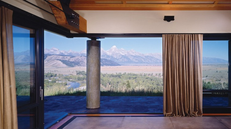 A steel framed window wall opens to the valley below with views of the Teton Mountain Range. PHOTOS Courtesy of DYNIA Architects.