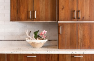 Steel introduces fine delicate lines to the kitchen cabinet design, and Snake River Interiors adds sleekly modern steel hardware