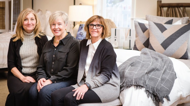 The Picket Fence sales team include Claire Cassano, Suzi Sander, and Barb Gerrish (pictured left to right).