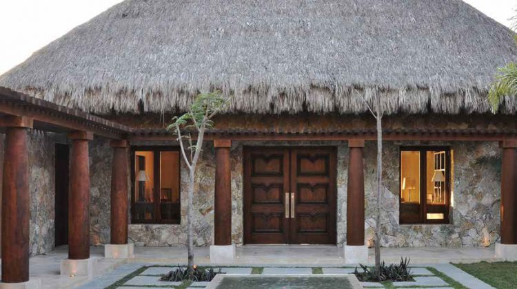 "This vacation home in a Mexican resort town outside of Puerto Vallarta was the second project that Woodland did for the couple. The double doors for this patio entrance echo the double doors from the main entrance in the front. Lynn Harker says, ""These doors are extraordinary and establish the tone for the home."" Certainly they set the expectations high for what's inside."