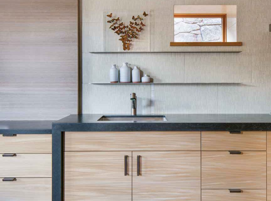 A contemporary kitchen by Sun Valley's Five Star Kitchen and Bath features flat-slab wood cabinets that offer the much-desired clean look.