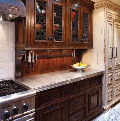 "When you choose custom cabinet work, whether fitted or unfitted, you can plan around and for the specific appliances you choose. Woodland's Lynn Harker says, ""We work closely with interior designers, architects, and homeowners to ensure that every piece we design, build, and install more than exceeds the designer's and homeowner's expectations. We take the idea of 'custom' to heart, and we finish every piece by hand—this is what allows for the intricacies that give each home its unique character; we make every piece with the highest quality material—absolutely no particle board."""