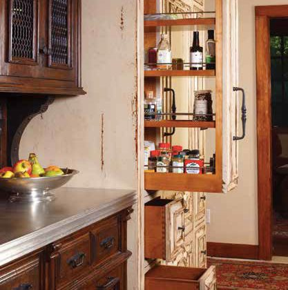 A kitchen with unique pieces offers unique storage solutions like these thin but long pantry cabinets.