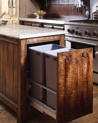A custom kitchen like this one by Woodland allows for special touches like these beautiful but practical storage pull-outs.