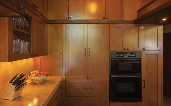 This transitional kitchen features Taft Design Works shaker-style cabinetry in a stained Alder finish.