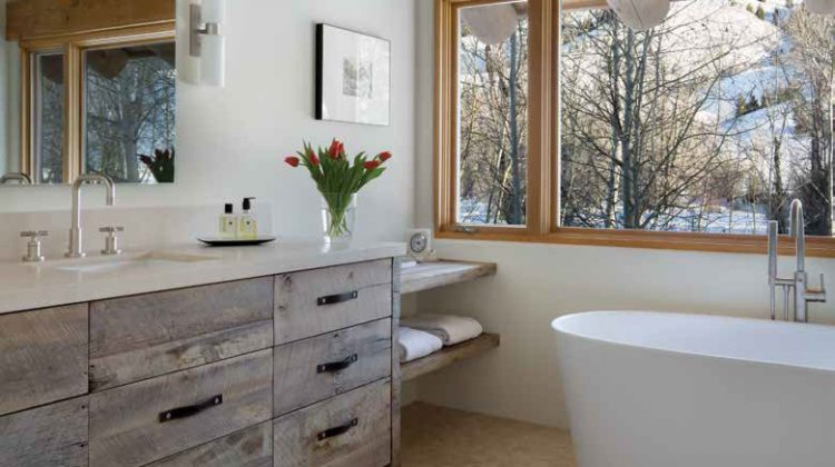 This Five Star master bathroom features reclaimed barnwood drawers in a modern flat front design with leather pulls.