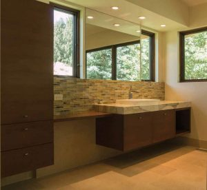 This Five Star Kitchen and Bath bathroom merges rustic and contemporary for a modern mountain look; clean, white cabinetry and grey accents are a winning combination.