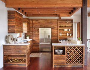 "This ""Ski Chalet"" designed by Hunter & Company Interior Design and built by Bear Mountain Builders features cabinets by The Old World Cabinet Company. The horizontal linearity of the cabinets is a nod to modern sensibilities, while the liberal use of wood in the kitchen offers echoes of traditional ski chalets."