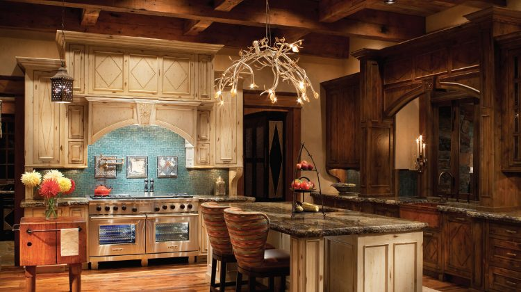 "A project designed by Hunter & Company Interior Design, the cabinets in this kitchen are by The Old World Cabinet Company. Ole Netteberg, founder and owner, has been living his passion for woodworking since 1969. He says, ""Every project, large or small, is about our connection with the client."""
