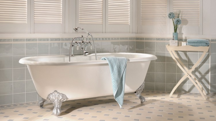 Freestanding white tub with tasteful tile