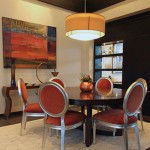orange chairs around table