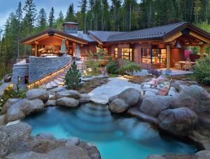 stones around resort styled home at dusk