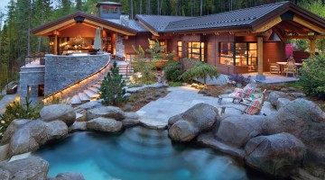 stones around resort styled home at dusk