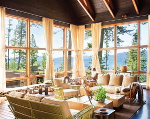 ABOVE Glass opens this Great room by Bigfork Builders to the inspiring views. PHOTO Gibeon Photography