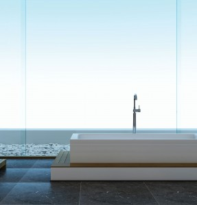 This freestanding tub framed by a wall of windows creates a dramatic centerpiece in this lakeside bathroom