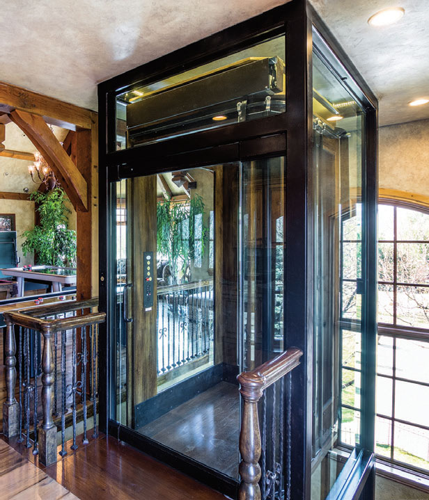 Jackson rising above western home journal luxury for Custom home elevators