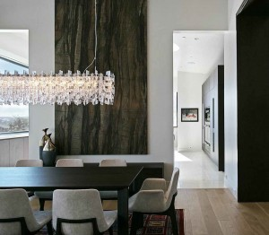 This chandelier does more than just offer light—it's a focal point for this area and a statement piece. Image courtesy of Elume.