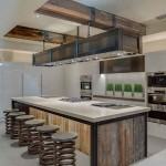 Steel and wood cabinets by Peppertree are a suprising and stunning addition to this kitchen. The artful use of steel through the kitchen blends well with the white and reclaimed wood. Photo Courtesy of Peppertree