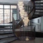 The juxtaposition of the industrial and contemporary steel staircase against the traditional yet stunning chandelier offers a grand statement in this project by Innovative Iron. PHOTO Courtesy of Innovative Iron