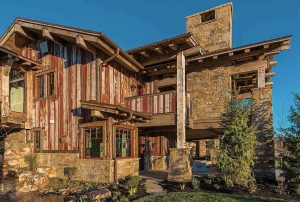 The exterior the home is full of character. The contractor, Mike Allred and his team meticulously went through lumber from 30 reclaimed structures to find the right lumber for this project.