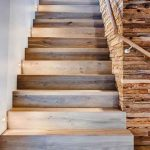 Hardwood stairway and wall detail in Arrigoni Wood by Earth Elements brings natural elements to this home in a contemporary way.